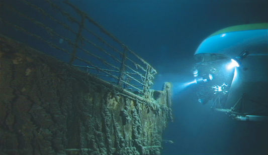 A submersible navigates around the Titanic.