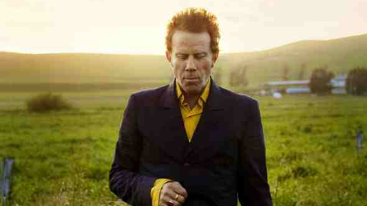 Tom Waits in a field
