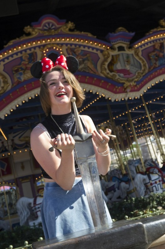 Game Of Thrones Star Maisie Williams Pulls Sword From The Stone At Disney World, August 2013