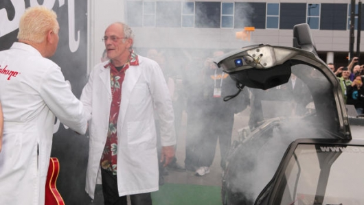Christopher Lloyd Arrives At CES In DeLorean