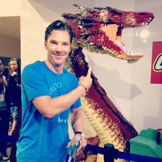 THE HOBBIT: THE BATTLE OF THE FIVE ARMIES star Benedict Cumberbatch with LEGO Dragon Smaug in the Warner Bros. booth at SDCC 2014.