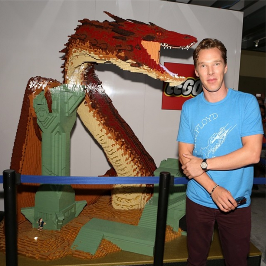 THE HOBBIT: THE BATTLE OF THE FIVE ARMIES star Benedict Cumberbatch poses alongside the LEGO Dragon Smaug in the Warner Bros. booth during SDCC 2014