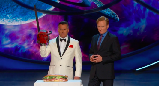 Bruce Campbell Chainsaws Sandwich On Conan SDCC 2016