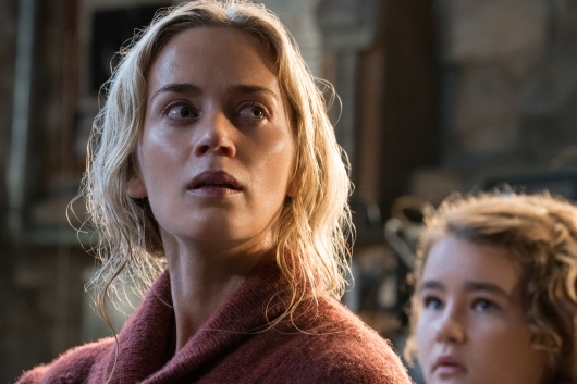 Movie Review: A Quiet Place. Left to right: Emily Blunt plays Evelyn Abbott and Millicent Simmonds plays Regan Abbott in A QUIET PLACE, from Paramount Pictures.
